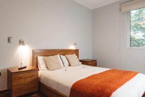 Cama o camas de una habitación en Departamentos Nice & Cool