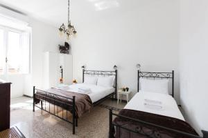 A bed or beds in a room at Apartment at Pigneto