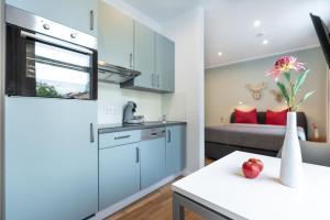 Küche/Küchenzeile in der Unterkunft Freiburg Apartments Friedrichring