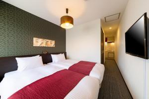 JAPANING HOTEL 西大路にあるベッド