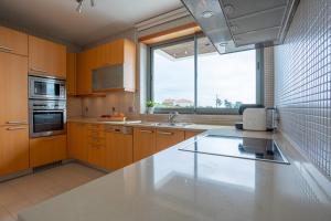 Køkken eller tekøkken på Casas da Pescaria A