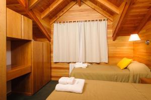 Una cama o camas en una habitación de Del Sauco Apart & Spa