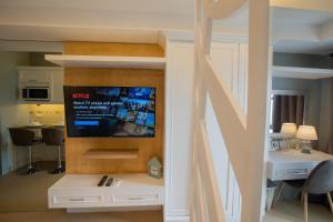 A television and/or entertainment center at CITY VIEW 2Oth FLR, Cebu IT Park, Pool AL