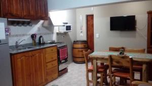 Una cocina o kitchenette en Departamentos Lugar de Descanso