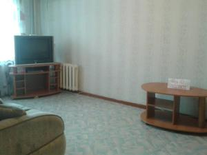A television and/or entertainment center at Apartments Kirova 28