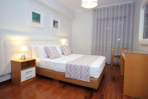 A bed or beds in a room at Subvilla Beach Place