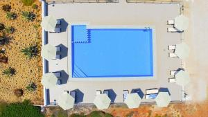 A view of the pool at Nanakis Beach Luxury Apartments or nearby