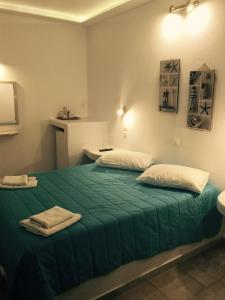 A bed or beds in a room at Evagelia's Place