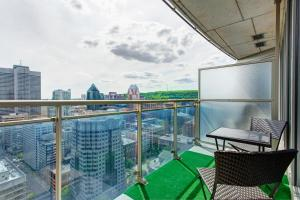 A balcony or terrace at Place des festivals furnished apartments