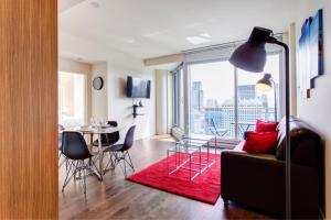 A seating area at Place des festivals furnished apartments