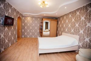 Кровать или кровати в номере Papanintsev 109