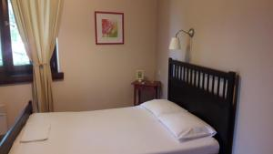 Een bed of bedden in een kamer bij Guesthouse Machi