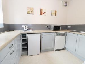 A kitchen or kitchenette at Mill Force Cottage, Barnard Castle