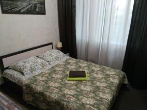 Кровать или кровати в номере KakDoma-SVO Studios