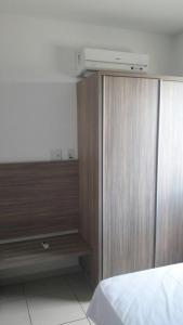 A bed or beds in a room at Apartamento no Riviera Park