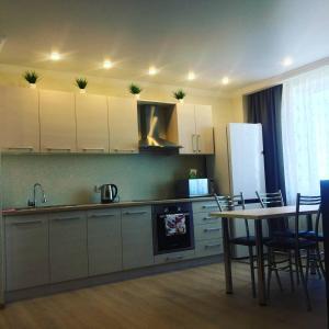 Кухня или мини-кухня в Двухкомнатная люкс