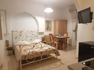 A bed or beds in a room at Sky Of Thira