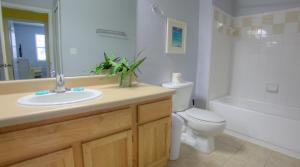 A bathroom at Runaway Beach Resort by Magical Memories -Disney Area