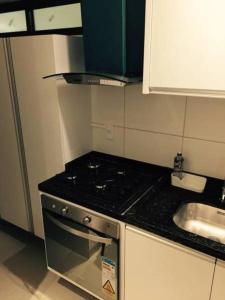 מטבח או מטבחון ב-Flat Green Ville Prime Select
