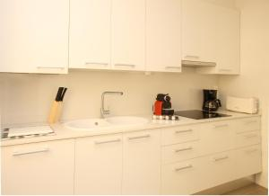 A kitchen or kitchenette at MH Apartments Suites