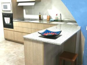 A kitchen or kitchenette at Casa Castillo de la Estrella