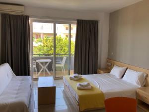Ένα ή περισσότερα κρεβάτια σε δωμάτιο στο Kleanthi Studios