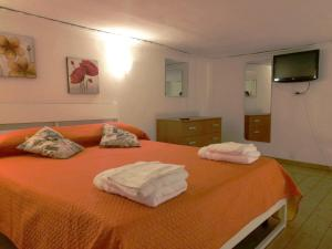 A bed or beds in a room at Ciuciu Naples Apartment
