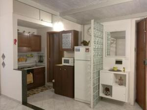 A kitchen or kitchenette at Ciuciu Naples Apartment