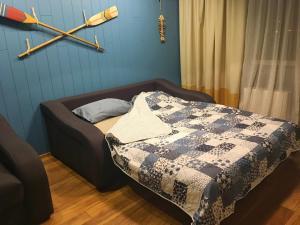 Кровать или кровати в номере Apartment on Ulitsa Divnaya 2