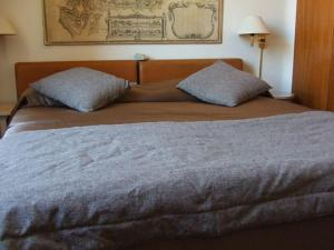 A bed or beds in a room at Palazzo Al Velabro