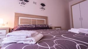 Cama o camas de una habitación en Apartamento nuevo con encanto