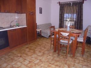 A kitchen or kitchenette at Soula Apartments & Studios