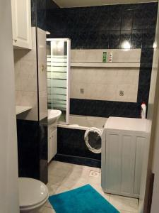 A bathroom at Beautiful apartment in the heart of our city