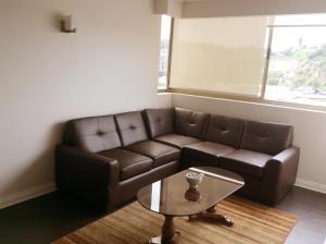 A seating area at Departamento 9 Norte