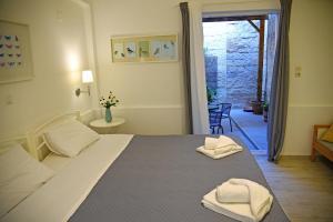 Ein Bett oder Betten in einem Zimmer der Unterkunft Castello Apartments