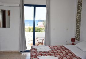 מיטה או מיטות בחדר ב-Kiotari Beach Apartments