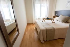 A bed or beds in a room at Sömn Apartments