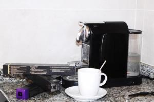 Coffee and tea-making facilities at Apartmentos Nort