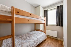 A bunk bed or bunk beds in a room at Leonetto