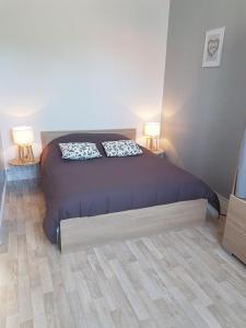 Un ou plusieurs lits dans un hébergement de l'établissement Gîtes Le Clos Du Val Marin