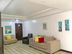 A seating area at Apartamento 3 quartos Salvador