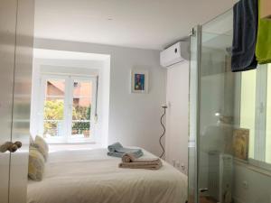 Een bed of bedden in een kamer bij LV Premier C.Ourique