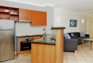 A kitchen or kitchenette at Waterfront Terraces