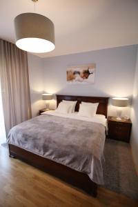 Postel nebo postele na pokoji v ubytování Soul Dance Apartments