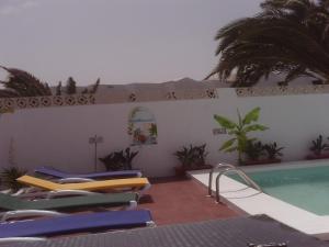 The swimming pool at or near Villa Acoran