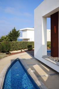 Бассейн в Paradise Cove Luxurious Beach Villas или поблизости