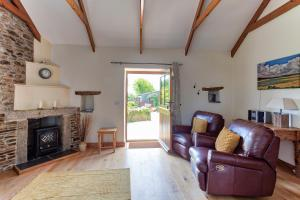A seating area at Tregolls Farm Cottages