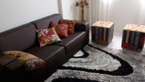 A seating area at Flat Recife
