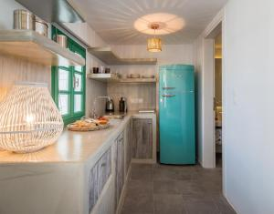 A kitchen or kitchenette at Babounis Suite