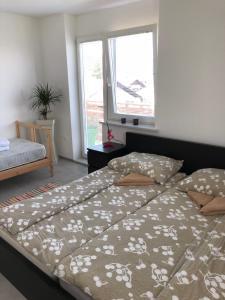 Postelja oz. postelje v sobi nastanitve Ljubljana View